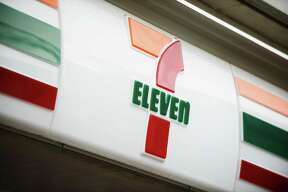 The 7-Eleven logo is displayed at a convenience store, operated by Seven & i Holdings Co., in Kawasaki City, Kanagawa Prefecture, Japan, on Tuesday, April 5, 2016. Seven & i is scheduled to report earnings on April 7. Photographer: Akio Kon/Bloomberg
