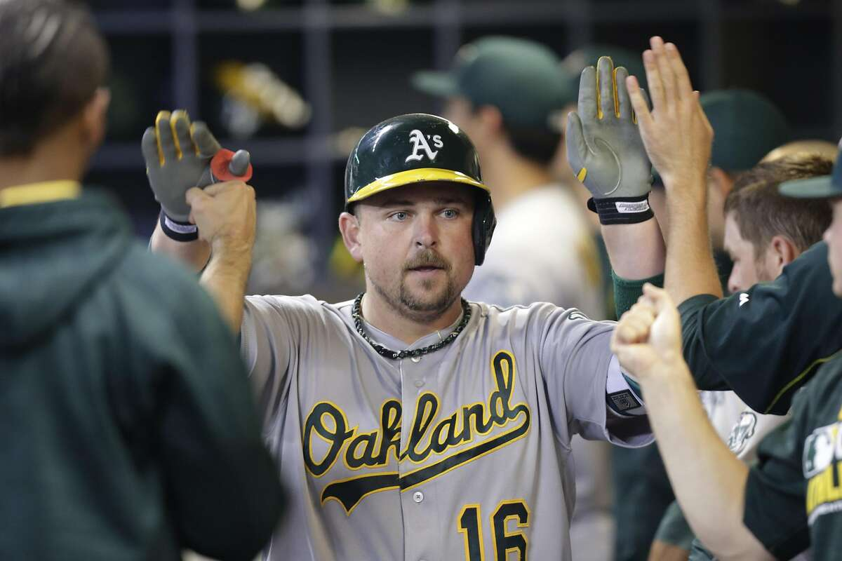 MILWAUKEE, WI - JUNE 07: Billy Butler #16 of the Oakland Athletics celebrates in the dugout after hitting a two run homer during the seventh inning of the Interleague game against the Milwaukee Brewers at Miller Park on June 07, 2016 in Milwaukee, Wisconsin. (Photo by Mike McGinnis/Getty Images)