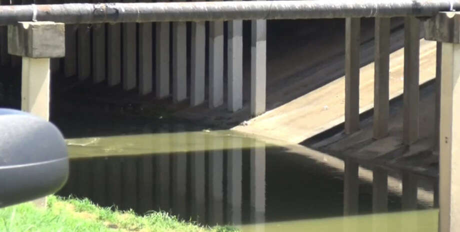 A body was found in Brays Bayou in the south end of Arthur Storey Park on Sunday. Photo: Metro Video