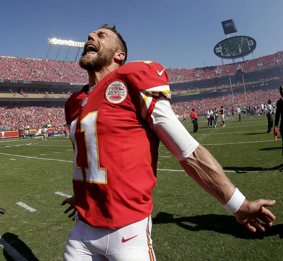 Chiefs quarterback Alex Smith doesn't hold anything back in celebrating his game-winning rushing touchdown in overtime to cap a 21-point comeback against the Chargers. Photo: Charlie Riedel, Associated Press