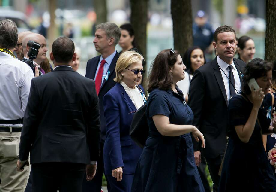 "Hillary Clinton at a ceremony to mark the 15th anniversary of the 9/11 terrorist attacks, at the National September 11 Memorial & Museum in New York, Sept. 11, 2016. Clinton abruptly left the ceremony before it concluded because she became ""overheated,"" according to a campaign spokesman. ""During the ceremony, she felt overheated, so she departed to go to her daughter's apartment, and is feeling much better,"" said Nick Merrill, a Clinton spokesman.  Photo: ERIC THAYER, NYT"