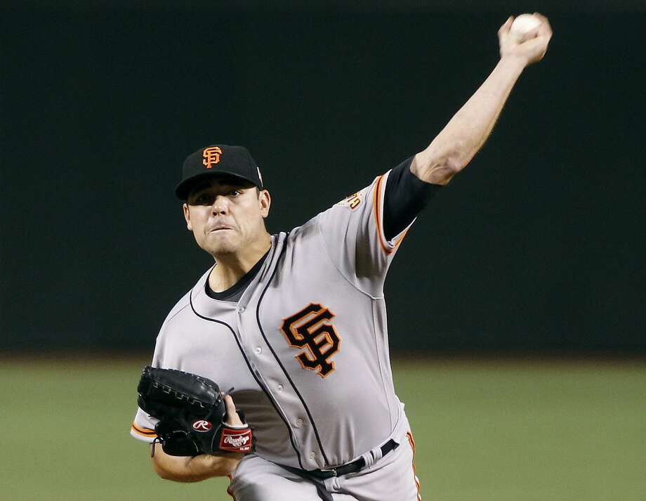 San Francisco Giants' Matt Moore throws a pitch against the Arizona Diamondbacks during the first inning of a baseball game, Sunday, Sept. 11, 2016, in Phoenix. (AP Photo/Ralph Freso) Photo: Ralph Freso, Associated Press