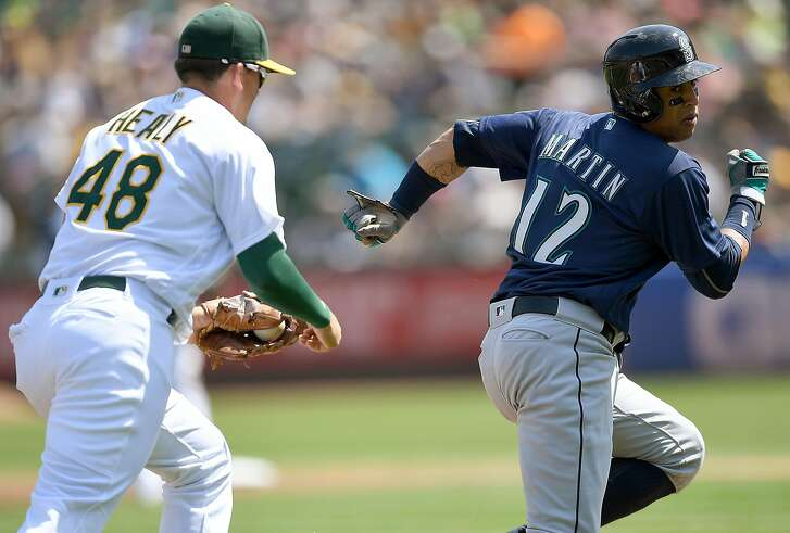 OAKLAND, CA - SEPTEMBER 11: Leonys Martin #12 of the Seattle Mariners is caught in a rundown chased by Ryon Healy #48 of the Oakland Athletics in the top of the second inning at Oakland-Alameda County Coliseum on September 11, 2016 in Oakland, California. (Photo by Thearon W. Henderson/Getty Images)