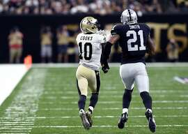 New Orleans Saints wide receiver Brandin Cooks (10) pulls in a touchdown reception in front of Oakland Raiders defensive back Sean Smith (21) in the second half of an NFL football game in New Orleans, Sunday, Sept. 11, 2016. The play was longer than any in the NFL last year, and was the longest  touchdown pass in Saints history. (AP Photo/Bill Feig)