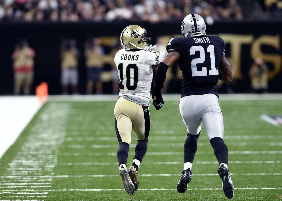 New Orleans Saints wide receiver Brandin Cooks (10) pulls in a touchdown reception in front of Oakland Raiders defensive back Sean Smith (21) in the second half of an NFL football game in New Orleans, Sunday, Sept. 11, 2016. The play was longer than any in the NFL last year, and was the longest  touchdown pass in Saints history. (AP Photo/Bill Feig) Photo: Bill Feig, Associated Press