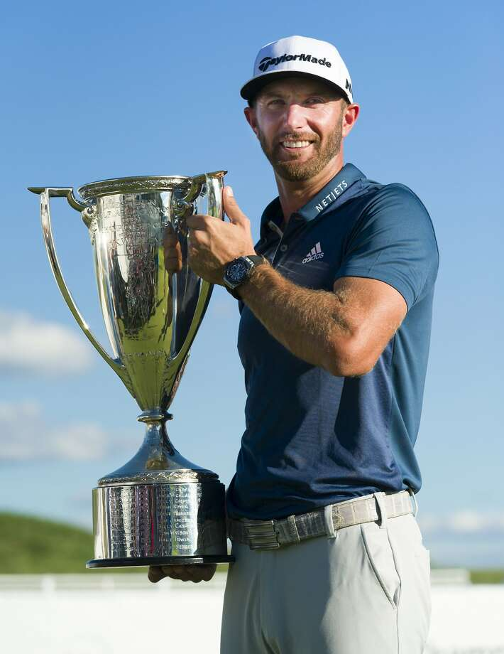 Dustin Johnson with the BMW trophy