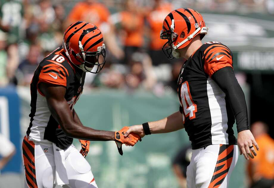 Bengals receiver A.J. Green (left) and quarterback Andy Dalton celebrate a touchdown with a gentlemanly handshake. Photo: Streeter Lecka, Getty Images