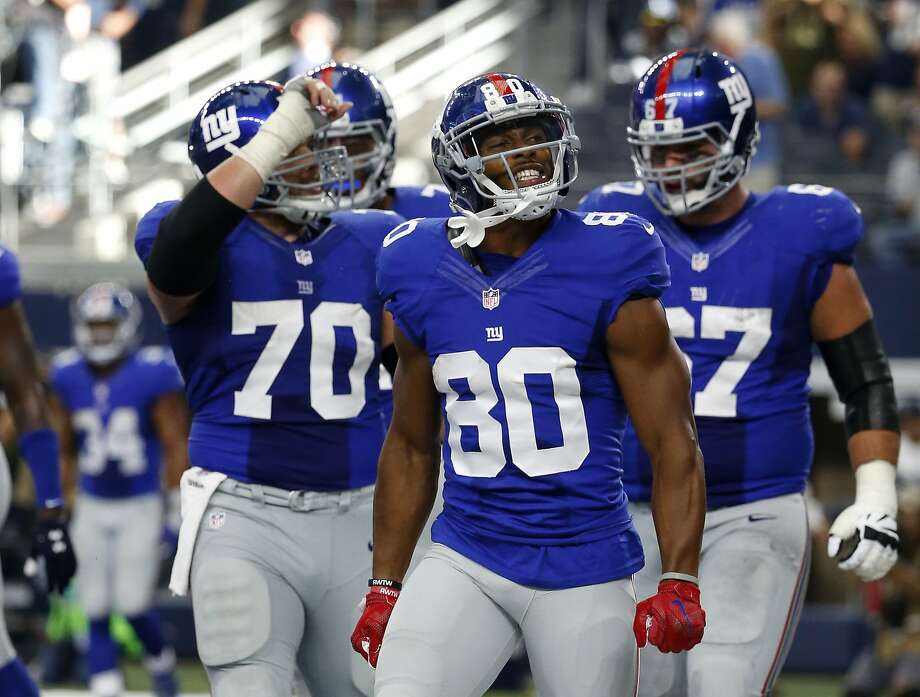 New York Giants center Weston Richburg (70), Victor Cruz (80) and Justin Pugh (67) celebrate a touchdown catch by Victor Cruz (80) in the second half of an NFL football game against the Dallas Cowboys on Sunday Sept. 11, 2016, in Arlington, Texas. (AP Photo/Michael Ainsworth) Photo: Michael Ainsworth, Associated Press
