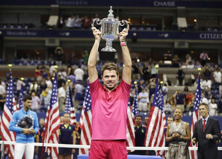 Stan Wawrinka's strong play forced Novak Djokovic (left) in to the background as the Swiss player won his first U.S. Open title. Wawrinka beat Djokovic 6-7 (1), 6-4, 7-5, 6-3. Photo: Darron Cummings, Associated Press