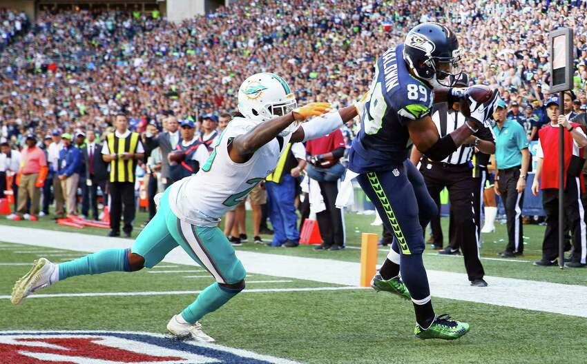 Seahawks wide receiver Doug Baldwin catches the winning touchdown pass as Dolphins corner back Bobby McCain defends in the final minutes of the fourth quarter of the Seahawks season opening game against Miami, Sunday, Sept. 11, 2016, at CenturyLink Field.