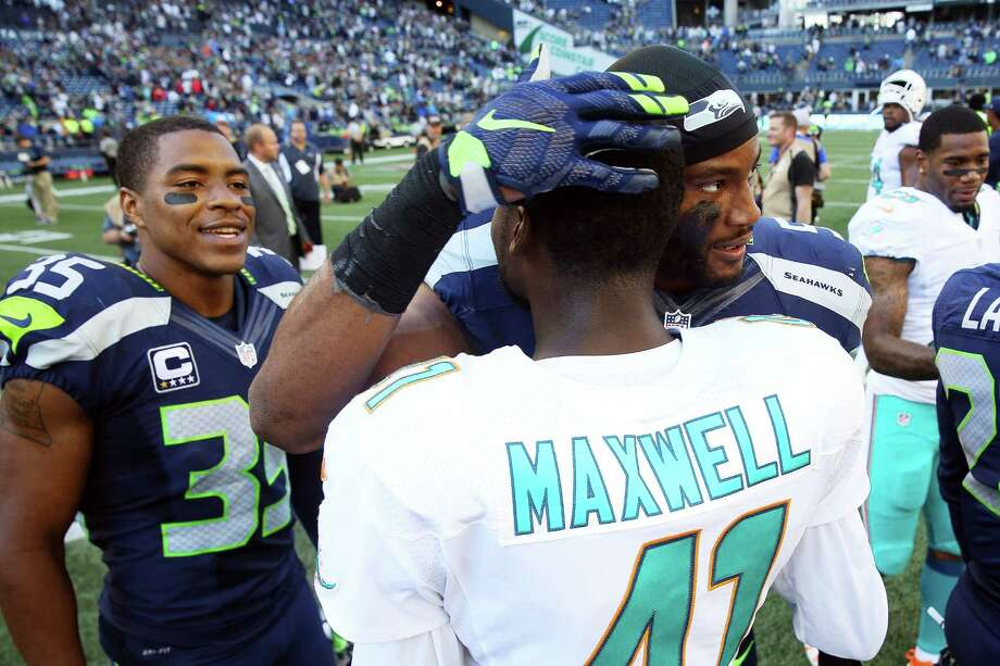 Seahawks Deshawn Shead and Mike Morgan greet Dolphins corner back and former Seahawk Byron Maxwell after the Seahawks season opening game against Miami, Sunday, Sept. 11, 2016, at CenturyLink Field. Seattle won 12-10. Photo: GENNA MARTIN, SEATTLEPI.COM / SEATTLEPI.COM