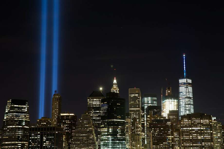 "The ""Tribute in Light"" illuminates the skyline of Lower Manhattan as seen from the Brooklyn Heights Promenade, September 11, 2016 in New York City. Throughout the country services are being held to remember the 2,977 people who were killed in New York, at the Pentagon and in a field in rural Pennsylvania. Photo: Drew Angerer, Getty Images"