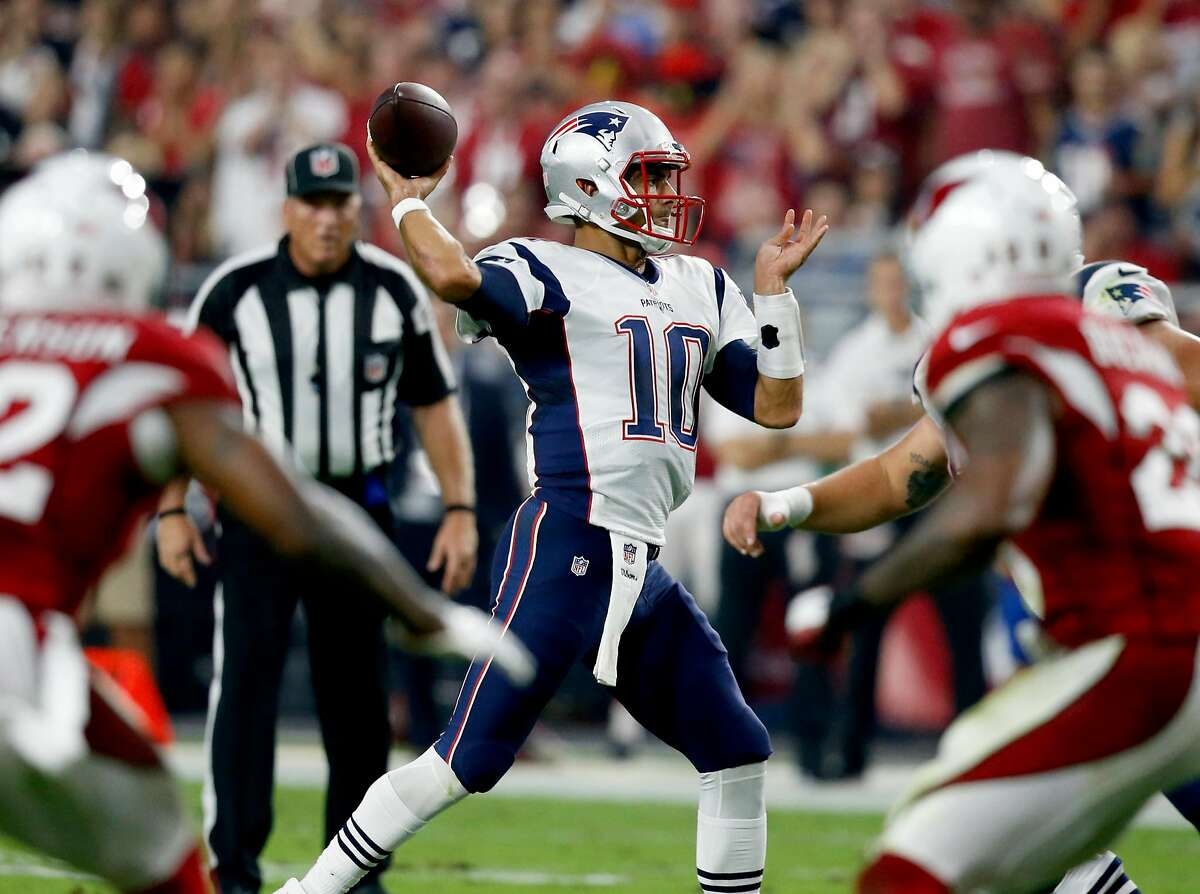 New England Patriots quarterback Jimmy Garoppolo (10) throws against the Arizona Cardinals during an NFL football game, Sunday, Sept. 11, 2016, in Glendale, Ariz. (AP Photo/Ross D. Franklin)
