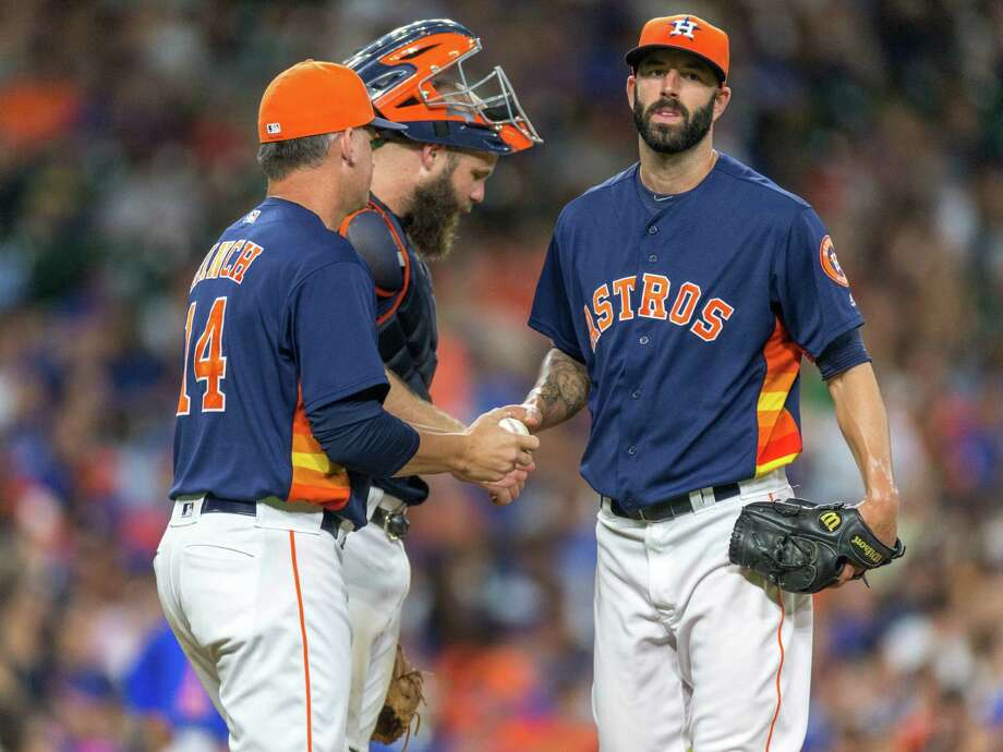 Houston Astros manager A.J. Hinch (14) retrieves the ball from Houston Astros starting pitcher Mike Fiers in the third inning of a baseball game between the Houston Astros and the Chicago Cubs, Sunday, Sept. 11, 2016, in Houston. (AP Photo/Juan DeLeon) Photo: Juan DeLeon, Associated Press / FR171058 AP