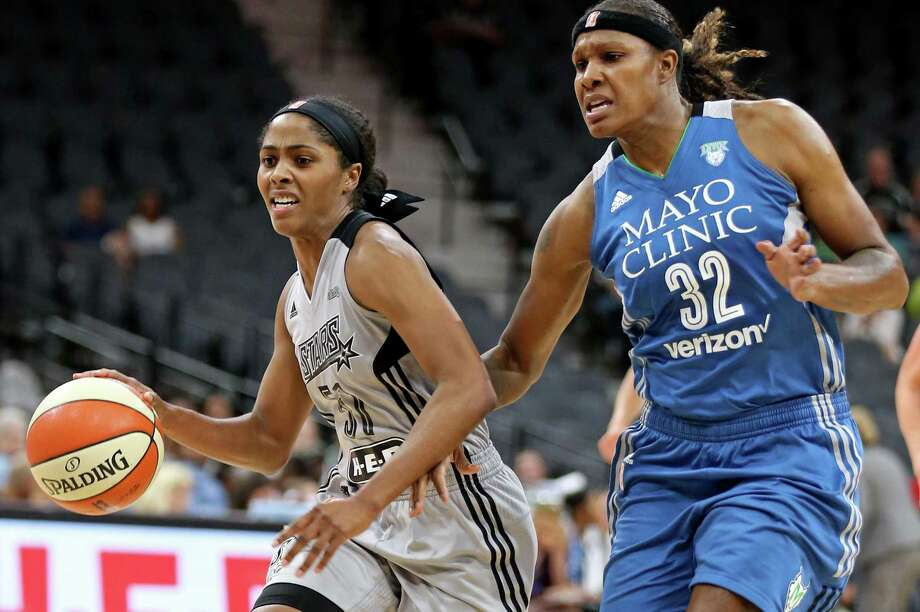 Stars' Sydney Colson drives around the Minnesota Lynx's Rebekkah Brunson during first half action on Sept. 11, 2016 at the AT&T Center. Photo: Edward A. Ornelas /San Antonio Express-News / © 2016 San Antonio Express-News