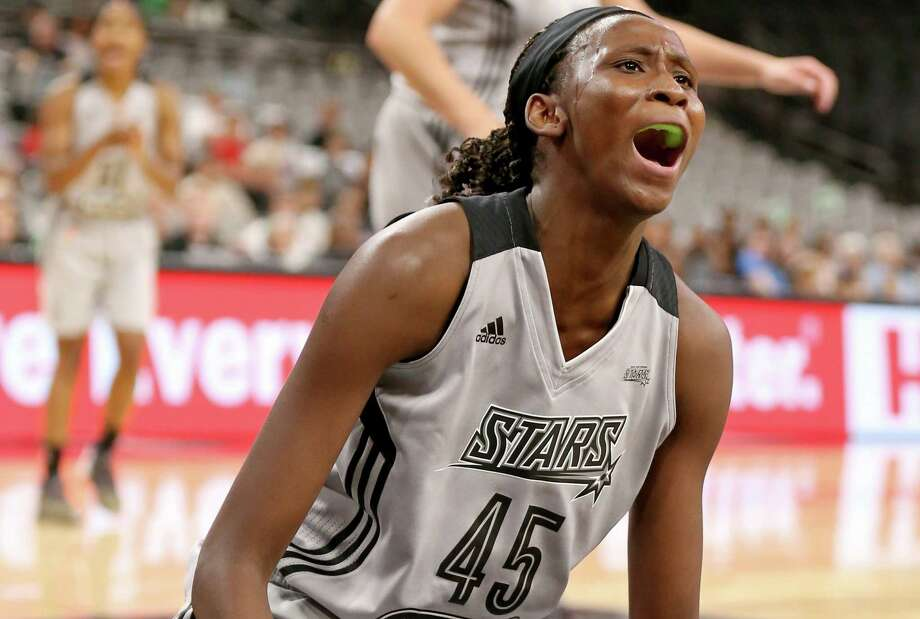 Stars' Astou Ndour reacts after being fouled by the Minnesota Lynx's Natasha Howard during first-half action on Sept. 11, 2016 at the AT&T Center. Photo: Edward A. Ornelas /San Antonio Express-News / © 2016 San Antonio Express-News