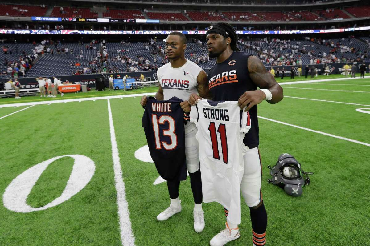 Houston Texans wide receiver Jaelen Strong, left, and Chicago Bears wide receiver Kevin White, right, trade their jersey after an NFL football game Sunday, Sept. 11, 2016, in Houston. Houston won 23-14. (AP Photo/David J. Phillip)