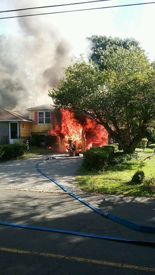 A house fire on Glenbrook Road in Orange sent a homeowner to the hospital. Photo: Courtesy Orange Volunteer Fire Co.