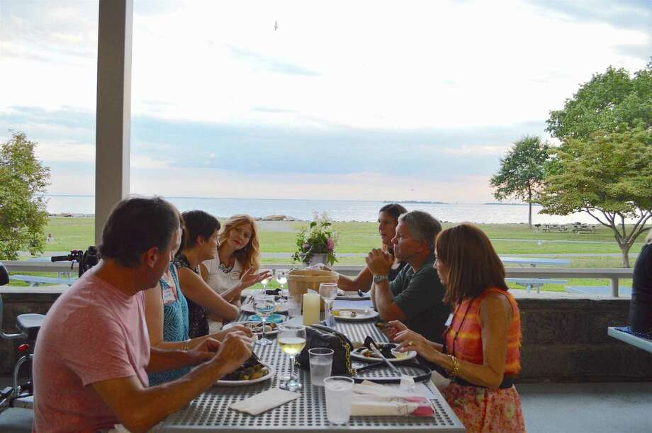 A gorgeous backdrop for al fresco dining at the Friends of Sherwood Island State Park Shorefest fundraiser, Friday, Sept. 9, 2016, in Westport, Conn. Photo: Jarret Liotta / For Hearst Connecticut Media / Westport News Freelance