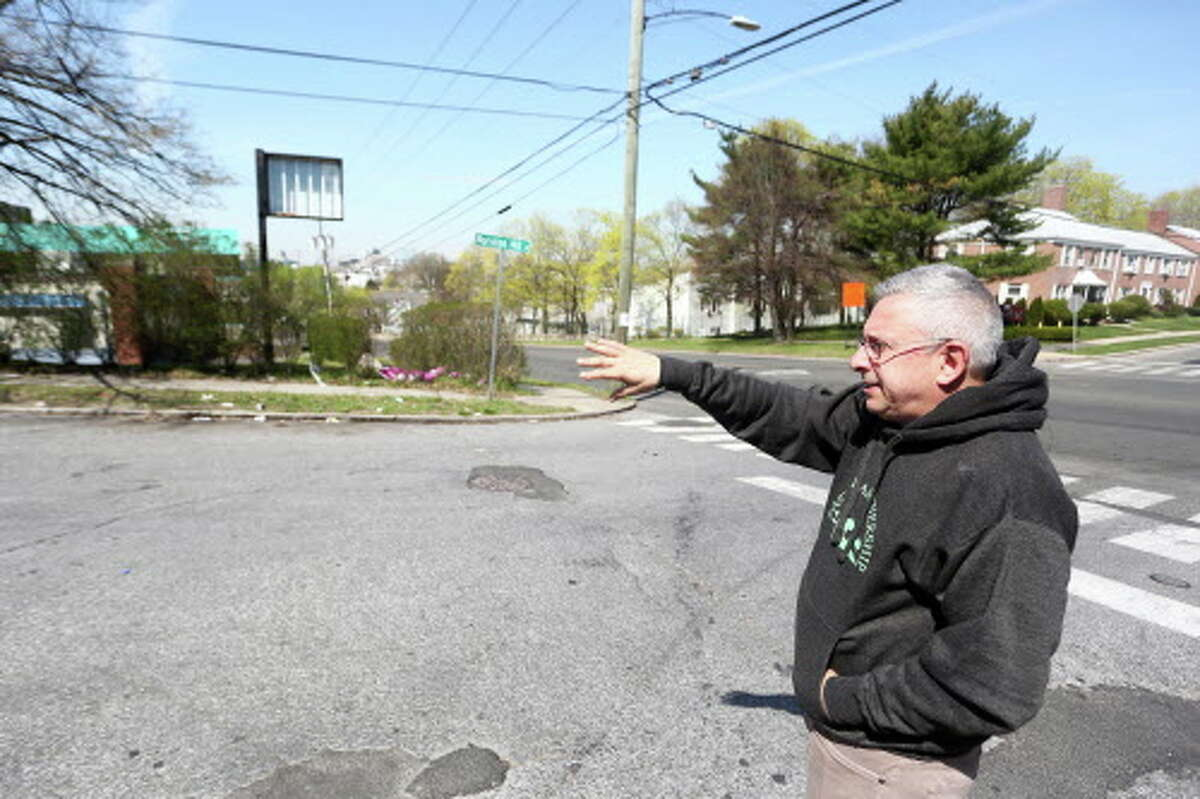 James Grunberger, chairman of the East Side Partnership, points to an area of Noroton Hill Place that needs to be cleaned during a scouting mission on Thursday, April 21, 2016. Grunberger and several other Partnership members scouted the area in preperation for a neighborhood cleanup on Saturday and before the scouting, Noroton Hill Place was not considered for cleanup.