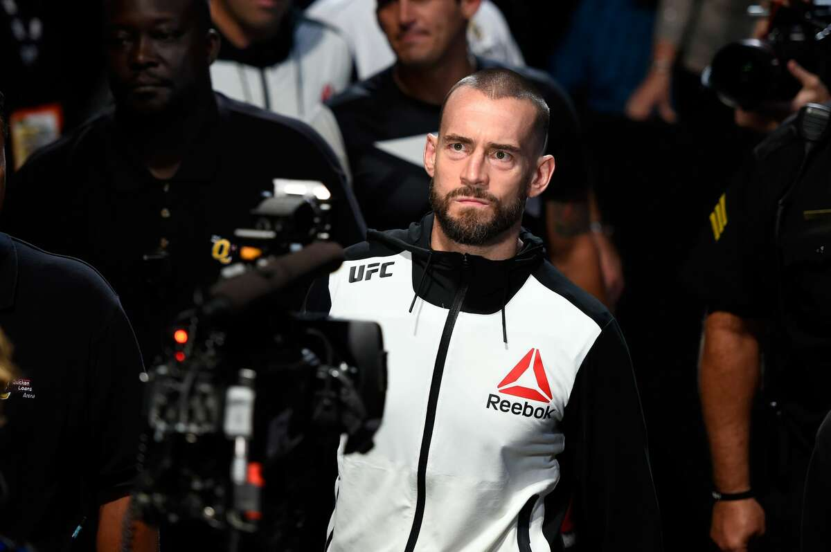 CLEVELAND, OH - SEPTEMBER 10: Phil 'CM Punk' Brooks enters the arena prior to facing Mickey Gall in their welterweight bout during the UFC 203 event at Quicken Loans Arena on September 10, 2016 in Cleveland, Ohio. (Photo by Josh Hedges/Zuffa LLC/Zuffa LLC via Getty Images)