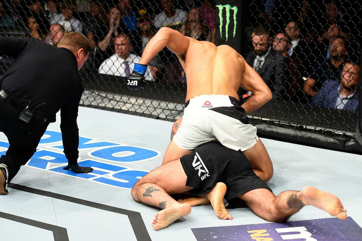 CLEVELAND, OH - SEPTEMBER 10: Mickey Gall (top) punches Phil 'CM Punk' Brooks in their welterweight bout during the UFC 203 event at Quicken Loans Arena on September 10, 2016 in Cleveland, Ohio. (Photo by Josh Hedges/Zuffa LLC/Zuffa LLC via Getty Images)