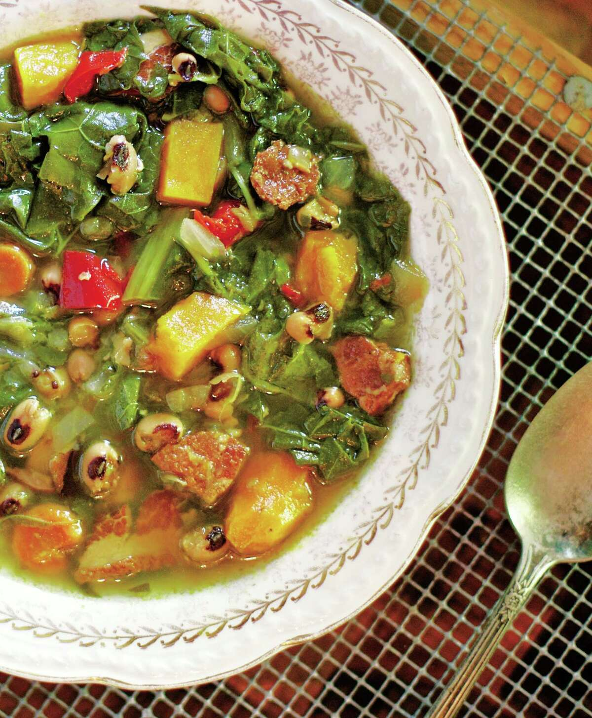 """Collard, Black-Eyed Pea, Andouille and Sweet Potato Soup is a dish from George Graham's """"Acadiana Table."""""""