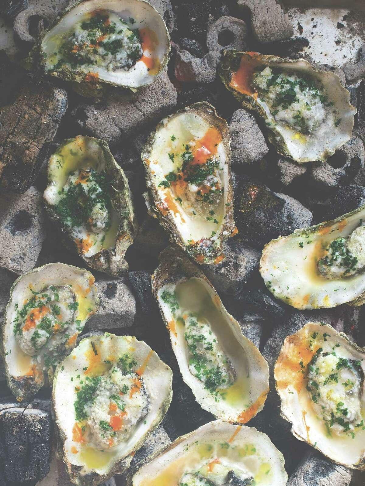 """""""Deep South: New Southern Cooking"""" by Brad McDonald includes a recipe for Grilled Oysters New Orleans-Style."""