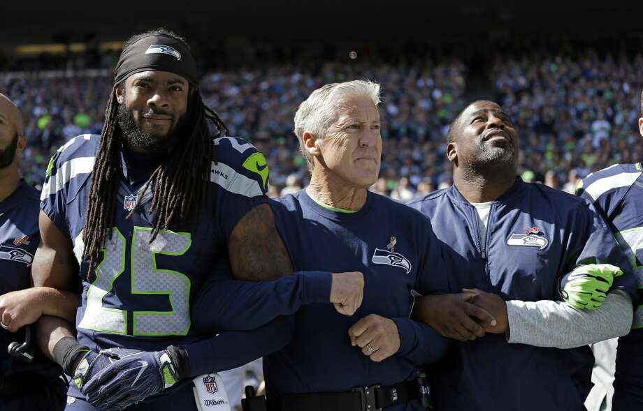 """Richard Sherman, Seahawks cornerback:""""People are so worried about (Michael Bennett) sitting down during the National Anthem that they completely miss that message a lot of times. They want to be more angry at the action than the message. That is an unfortunate part of the world we live in nowadays. I wish that people would take it for what it is and make a difference and go out there and try and combat against racism, fascism, unnecessary violence, guys being discriminated against, you know, he was doing nothing wrong."""" Photo: Elaine Thompson/AP"""
