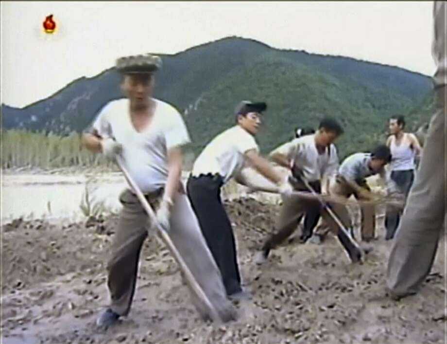 In this undated image from video distributed on Monday, Sept. 12, 2016, by North Korean broadcaster KRT, North Korean workers build levees along a river bank. North Korea is mobilizing to deal with a disastrous flood that killed more than 130 people, destroyed tens of thousands of homes and crippled infrastructure in its northern-most province. (KRT via AP) Photo: Associated Press