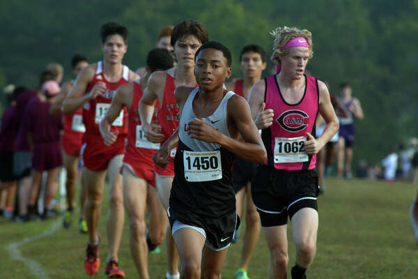 Langham Creek sophomore Jaron Smith (1450) leads a pack of runners during the Varsity Boys Elite 5000 Meter race at the UIL Region III Cross Country Meet at Kate Barr-Ross Park in Huntsville on Sept. 10, 2016. (Photo by Jerry Baker/Freelance)