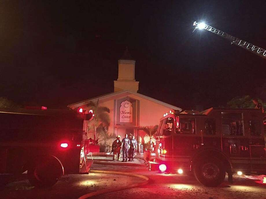 Firefighters respond to a blaze at the Islamic Center of Fort Pierce. Investigators believe the fire may have been a hate crime. Orlando nightclub gunman Omar Mateen attended the mosque. Photo: ST. LUCIE SHERIFF'S OFFICE, NYT
