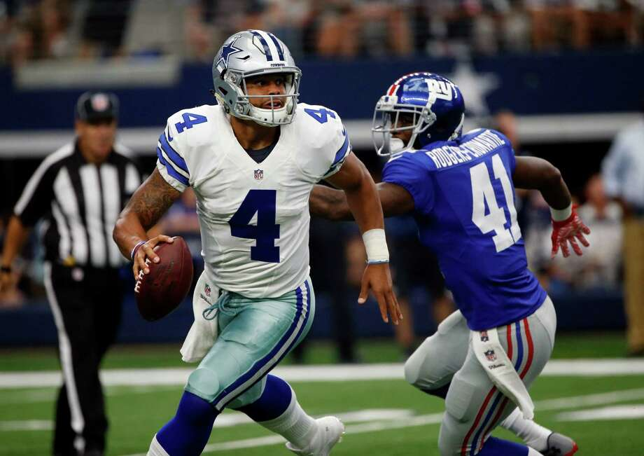 Dallas Cowboys quarterback Dak Prescott (4) is pressured by New York Giants cornerback Dominique Rodgers-Cromartie (41) during an NFL football game  on Sunday, Sept. 11, 2016, in Arlington, Texas. (AP Photo/Ron Jenkins) Photo: Ron Jenkins, Associated Press / FR171331 AP
