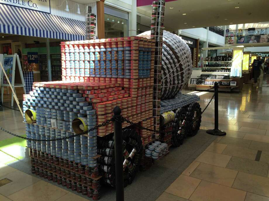 "A cement mixer made of canned goods is the Canstruction work ""Paving Our Way Out Of Hunger"" by RVK Architects and Lundy & Franke Engineering. It won for structural ingenuity; the cute little cement mixer was made of 8,210 cans. Photo: Steve Bennett /Express-News / Express-News"
