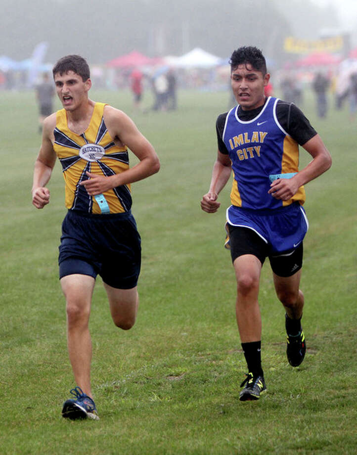 Bad Axe's Kendal Delpiere is side by side with Imlay City's Raul Rodriguez.
