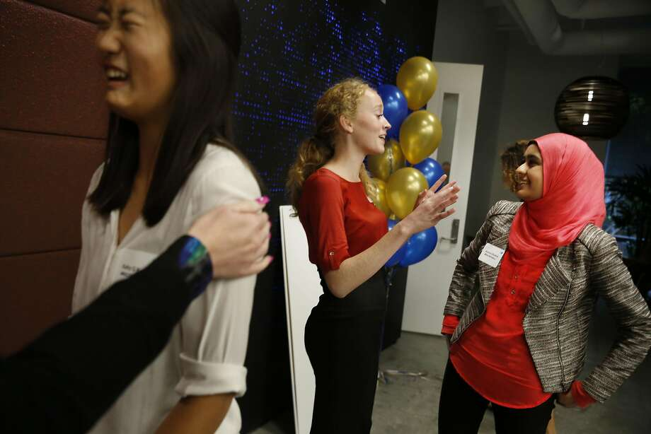 Erin Smith (center), the founder of FacePrint, talks with Let Girls Build finalist Juvaria Shahid, who founded #BuildYourBravery. Kathy Kong (left), gets congratulated for the Tara project, founded with Lillian Yuan. Photo: Lea Suzuki, The Chronicle
