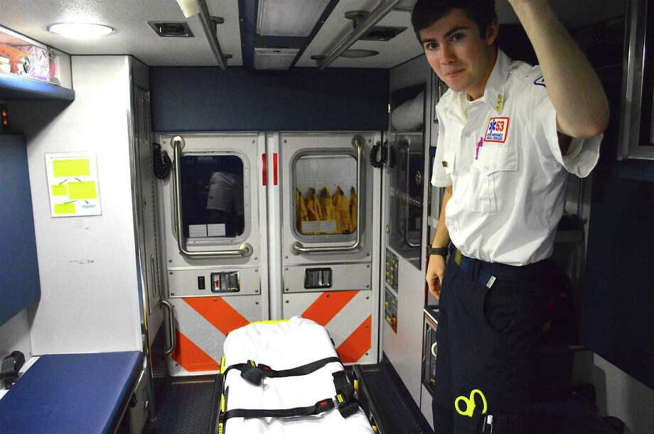 Darien EMS President Alex Cohen, 17, shares a look inside an ambulance when the Chamber of Commerce toured Darien EMS Post 52 in Darien, Conn., Thursday, Sept. 9, 2016. Photo: Jarret Liotta / For Hearst Connecticut Media / Darien News Freelance