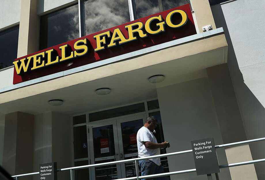 MIAMI, FL - SEPTEMBER 09:  A Wells Fargo sign is seen on the exterior of one of their bank branches on September 9, 2016 in Miami, Florida.  Reports indicate that more than 5,000 Wells Fargo employees have been fired as a result of a scandal involving employees that secretly set up new fake bank and credit card accounts in order to meet sales targets.  (Photo by Joe Raedle/Getty Images) Photo: Joe Raedle, Getty Images