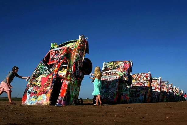 It's OK to add one's own artistic mark at the famed Cadillac Ranch.