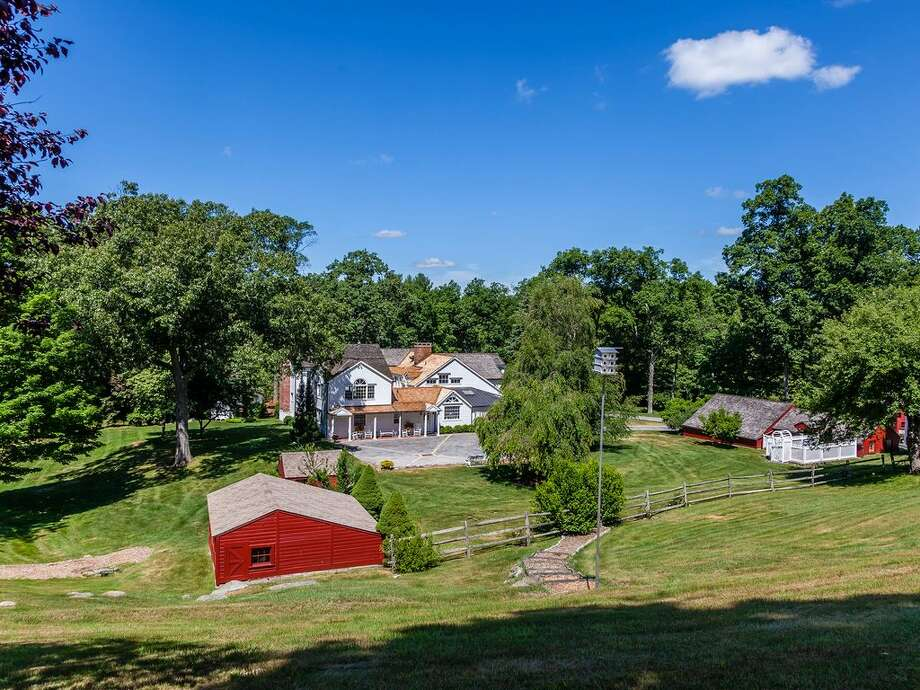 86 Roxbury Rd, Washington, CT 06793  Acres: 87.8 4 beds 5 baths 6,884 sqft  Features: Deck with a freestanding catering bar, pool, tennis court, guesthouse, party barn View full listing on Zillow Photo: Zillow
