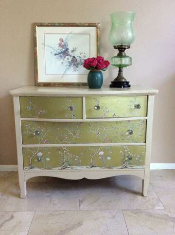 1of7AFTER: My old dresser got a makeover with antique white paint, wallpaper on the drawer fronts and faceted glass drawer pulls.Photo: Diane Cowen