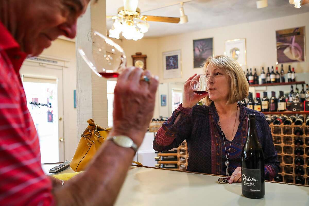 Cal Carrington (left) smells and tastes wine with Mary Quinn (right), at wine store, Carrington's Fine Wines, in Nevada City, California, on Thursday, Sept. 1, 2016.