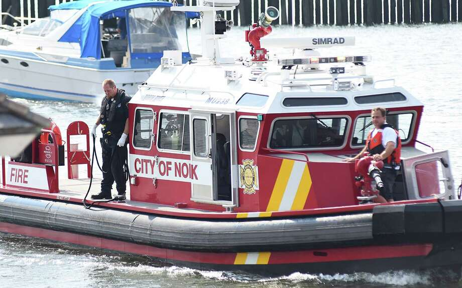 Norwalk firefighters assist in the rescue of a boater who fell overboard Saturday. Photo: Hearst Connecticut Media / John Nash
