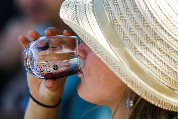Linnea Hardlund takes a sip of wine during a wine tasting at Pilot's Peak winery in Penn Valley, California, on Saturday, Sept. 3, 2016.
