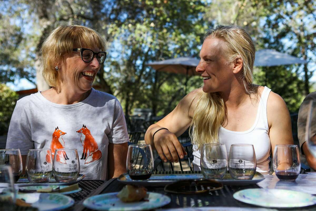 Mom Jeanie Cojerean chats with daughter Andrea Eggleton (right) during a wine tasting at Pilot's Peak winery in Penn Valley, California, on Saturday, Sept. 3, 2016.