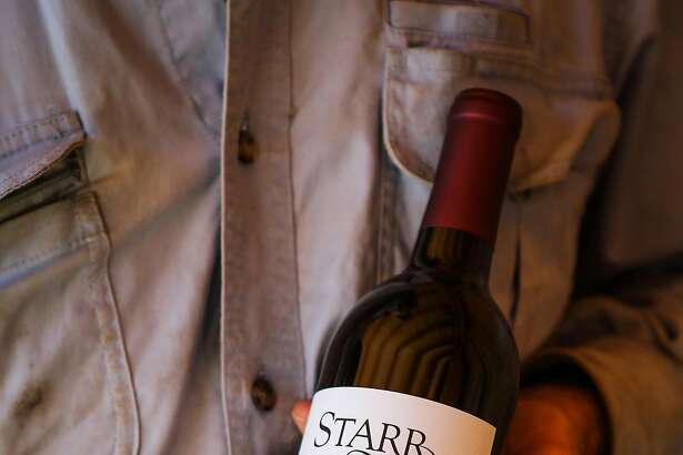 Owner Phil Starr holds a bottle of his Cabernet Franc, at Sierra Starr winery in Grass Valley, California, on Thursday, Sept. 1, 2016.