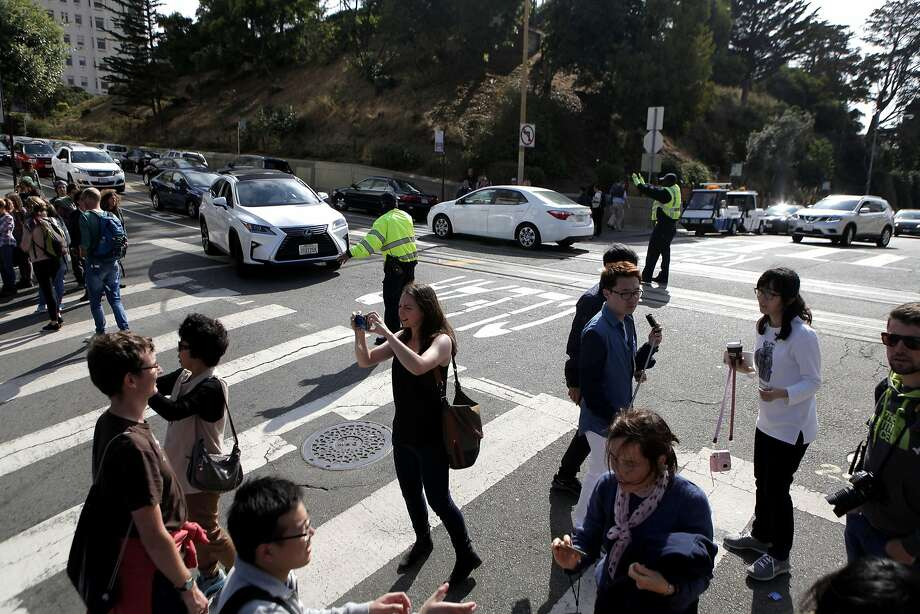 A crowd of tourists block traffic from traveling down Lombard St. in San Francisco on Saturday, September 10,  2016. Photo: Gabriella Angotti-Jones, The Chronicle