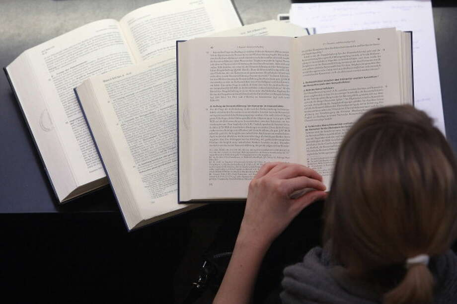 """Proposed textbook causes uproarA 54-page report has found more than 140 errors in a controversial textbook, entitled """"Mexican American Heritage,"""" that has been proposed for social studies classes in Texas public schools.Click through the gallery to see some of the errors identified by a committee of educators and historians.  / 2011 Getty Images"""
