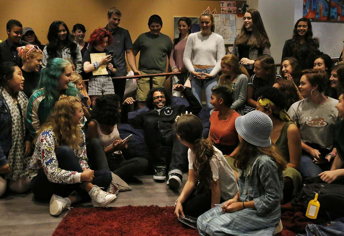 Teenagers from the teen center cheer and react as Hamilton star Daveed Diggs plops down in a bean bag chair for a group photo and a private question and answer session with them and Poetry Slam alum Chinaka Hodge at the Jewish Community Center of San Francisco Sept. 10, 2016 in San Francisco, Calif.