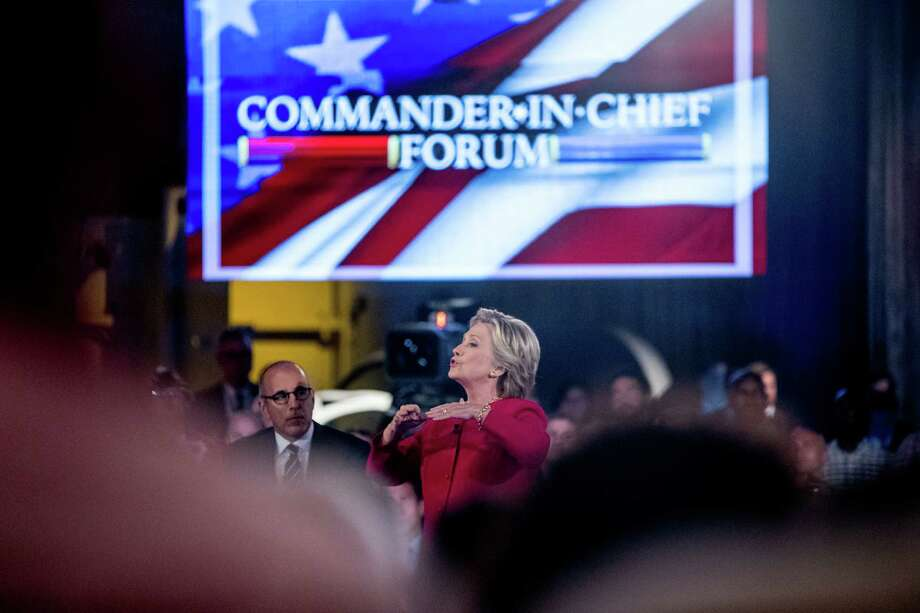 Democratic presidential candidate Hillary Clinton, accompanied by Today show co-anchor Matt Lauer, left, speaks at the NBC Commander-In-Chief Forum aboard the decommissioned aircraft carrier Intrepid. A reader criticizes Clinton for her use of an email server. Photo: Andrew Harnik /Associated Press / AP
